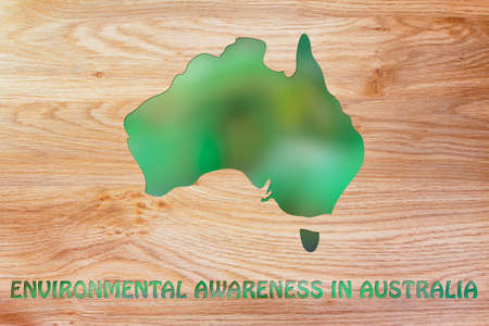 environmental awareness: environmental awareness throughout the world: illustration with map of australia made of green leaves blur