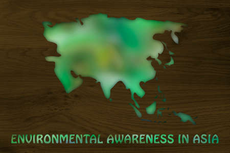 environmental awareness: environmental awareness throughout the world: illustration with map of asia made of green leaves blur