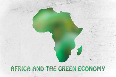 environmental awareness: environmental awareness and green economyy: illustration with map of africa made of green leaves blur