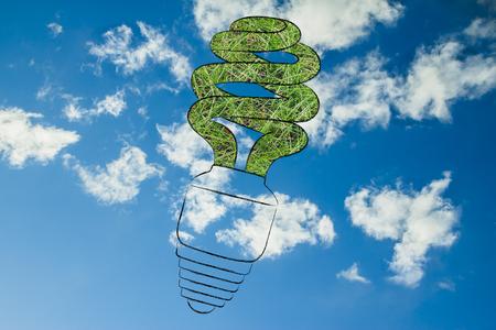 energy management: ecological energy saving lightbulb made of grass Stock Photo