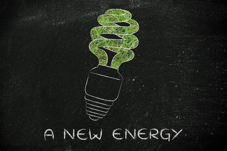 social behaviour: ecological low consumption lightbulb made of grass, a new energy Stock Photo