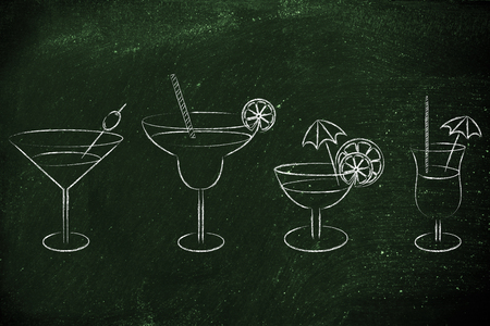 different style of drink glasses with straws, coktail umbrellas and lemon slices Archivio Fotografico