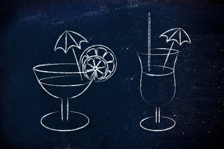 hour glasses: drink glasses with straws, coktail umbrellas and lemon slices