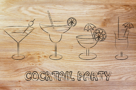 parties and celebrations: different style of drink glasses with straws, coktail umbrellas and lemon slices
