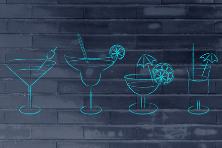 different style of drink glasses with straws, coktail umbrellas and lemon slices Stock Photo