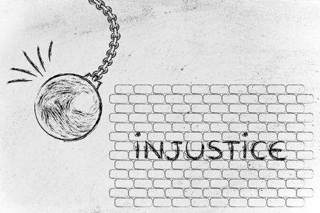injustice: building a better world, metaphor with wrecking ball destroying a wall of Injustice Stock Photo