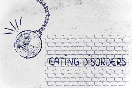 overcoming: overcoming your problems, metaphor with wrecking ball destroying Eating Disorders
