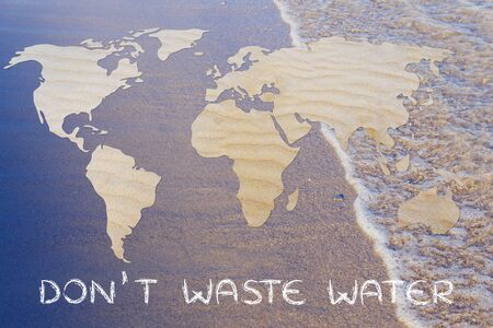 corporate waste: avoid wasting water: map of the world with desert sand pattern