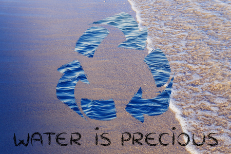 water is a precious natural resource: recycle symbol with sea pattern Stock Photo