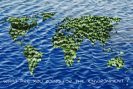 land management: green leaves world on ocean background, do your part for the environment Stock Photo
