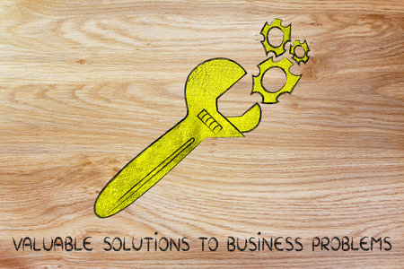 valuable: wrench made of gold repairing a mechanism, metaphor of valuable solutions to business problems Stock Photo
