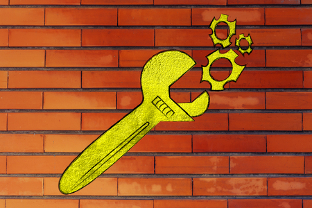 vision repair: wrench made of gold repairing a mechanism, metaphor of valuable solutions and inventions