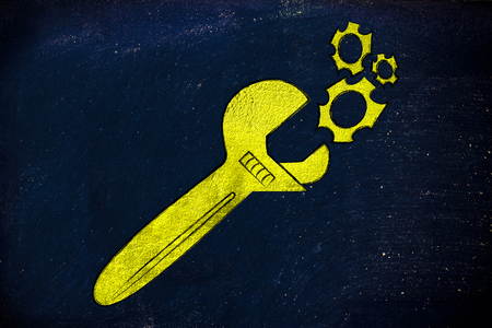 valuable: wrench made of gold repairing a mechanism, metaphor of valuable solutions and inventions