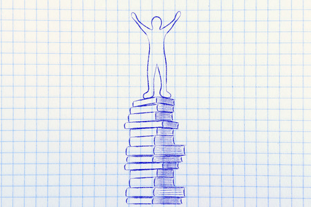 master degree: education and school goals: happy accomplished person on top of pile of books Stock Photo