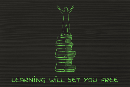 master degree: learning will set you free: happy accomplished person on top of pile of books