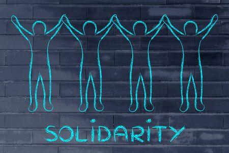 solidaridad: solidaridad: personas de la mano y de pie unidos Foto de archivo
