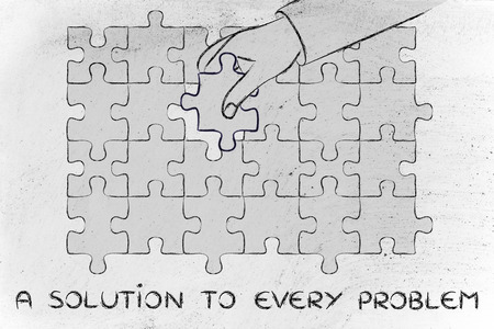 missing piece: a solution to every problem, hand about to add the missing piece to a jigsaw puzzle