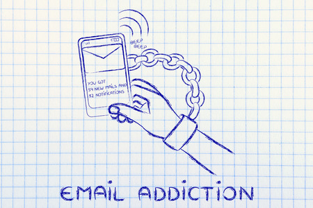 beeping: hand chained to a beeping mobile phone, concept of addiction to checking emails