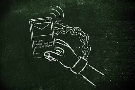 distraction: hand chained to a beeping mobile phone, concept of smartphone addiction