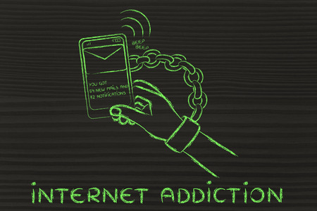 beeping: hand chained to a beeping mobile phone, concept of internet addiction