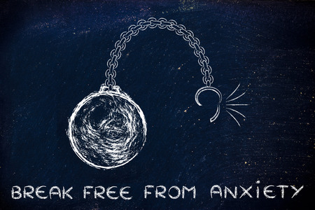 stress ball: ball and chain getting broken, metaphor of breaking free from anxiety Stock Photo