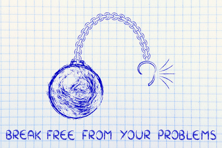 breaking free: ball and chain getting broken, metaphor of breaking free from problems