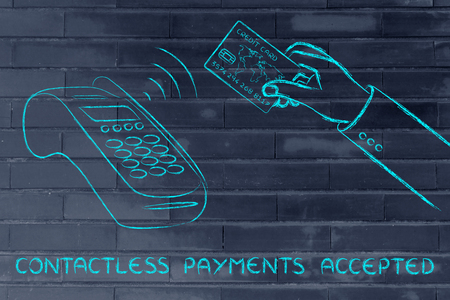 contactless: contactless payments accepted, client keeping the credit card near a pos terminal