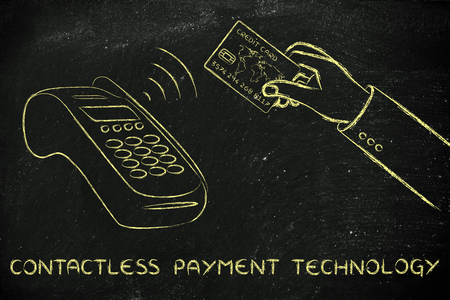 contactless: contactless payments technology, client keeping the credit card near a pos terminal Stock Photo