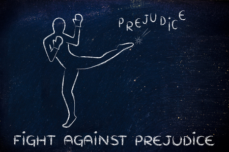 prejudice: fight against negative concepts: person kicking away the word prejudice Stock Photo