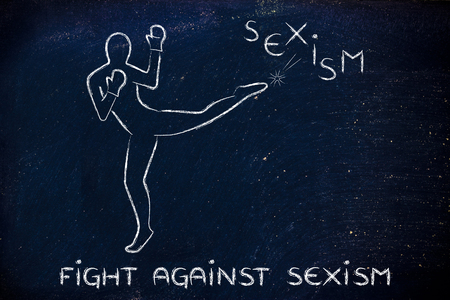 fight against negative concepts: person kicking away the word sexism Stock Photo