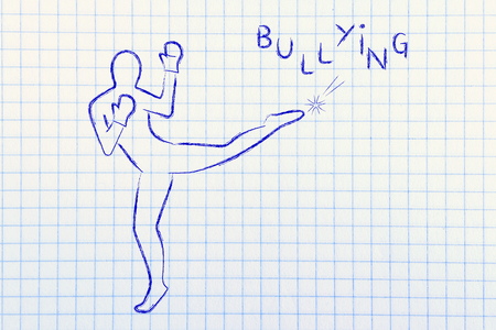 fight against negative concepts: person kicking away the word bullying