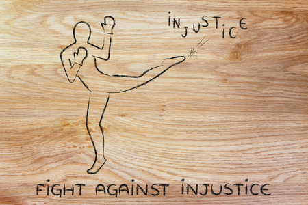 beings: fight against negative concepts: person kicking away the word injustice Stock Photo