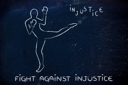 injustice: fight against negative concepts: person kicking away the word injustice Stock Photo