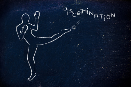 fight against negative concepts: person kicking away the word discrimination Stock Photo