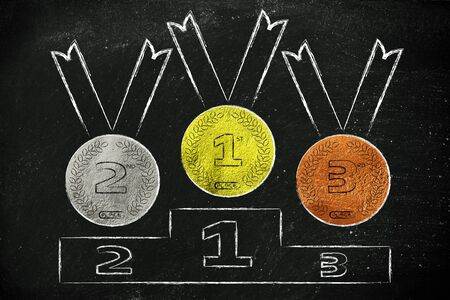 competitive advantage: gold, silver and bronze medals on podium, concept of competition and winning Stock Photo