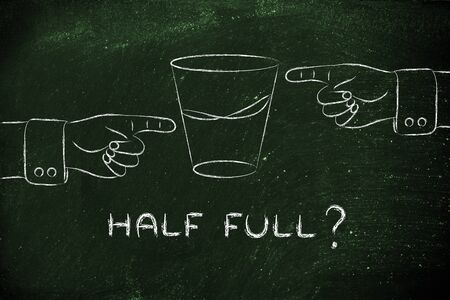 glass half full: half full: hands pointing at glass of water from opposite point of views Stock Photo