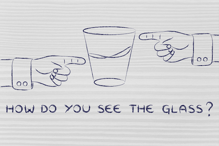 unhappiness: how do you see the glass: hands pointing at half full and half empty sides