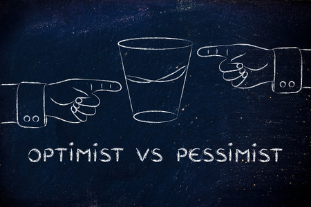 pessimist: optimist vs pessimist: hands pointing at half full and half empty sides of glass of water