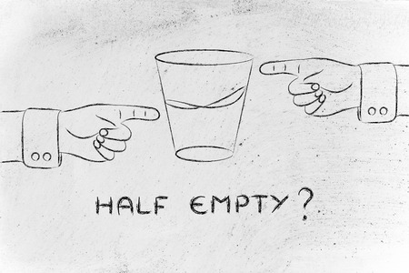 unhappiness: half empty: hands pointing at glass of water from opposite point of views