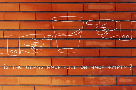 half full: is the glass half full or half empty: hands pointing from opposite point of views