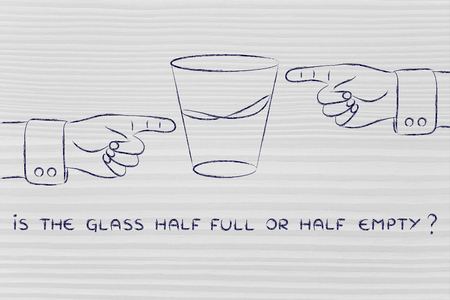 half and half: is the glass half full or half empty: hands pointing from opposite point of views