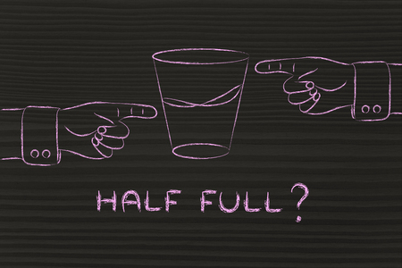 unhappiness: half full: hands pointing at glass of water from opposite point of views Stock Photo