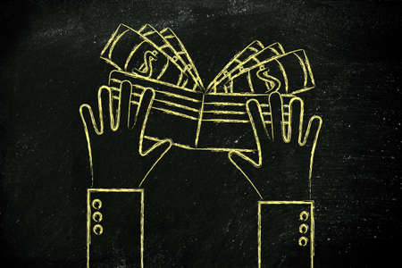 spending money: concept of saving and spending money: hands holding a wallet with cash