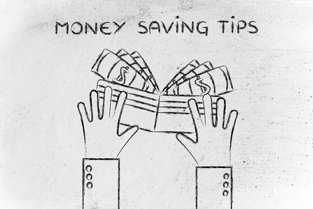 saving tips: concept of money saving tips: hands holding a wallet with cash Stock Photo