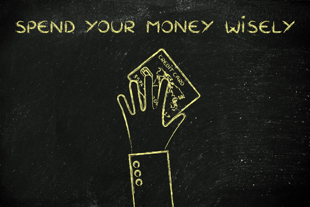 holding credit card: concept of spending money wisely: hand holding credit card