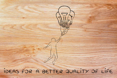 quality of life: ideas for a better quality of life: person flying by holding up to lightbulb shaped balloons Stock Photo