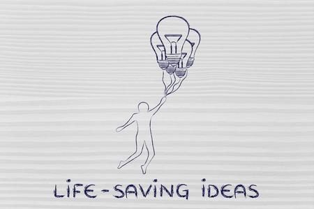 salvavidas: Ideas para salvar vidas: persona volando por explotación, hasta alcanzar globos en forma de bombilla Foto de archivo