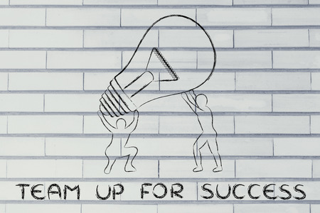 teaming: concept of teaming up for success: men lifting up a huge lightbulb