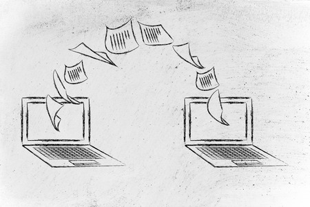 intranet: data exchange and intranet concept: laptops with documents flying from one screen to the other Stock Photo