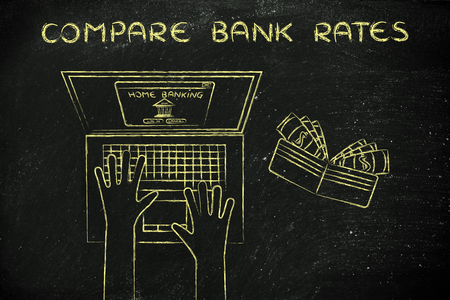 compare: compare bank rates: user typing on his laptop, with wallet and stats on his desk Stock Photo